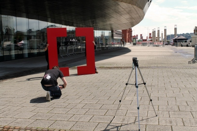 Cardiff School of Journalism student Toby Mott takes a picture of the Creative Cardiff big 'C's infront of Wales Millennium Centre