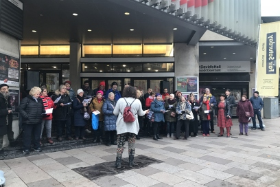 Choir performance outside St David's Hall on first Fair Saturday