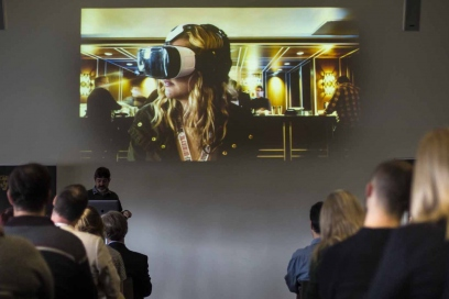 Attendees watch VR presentation at Visioning the New Realities